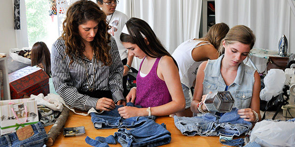 Kids work with local designer to make customized clothes during UGA GA Center Summer Fashion Camp