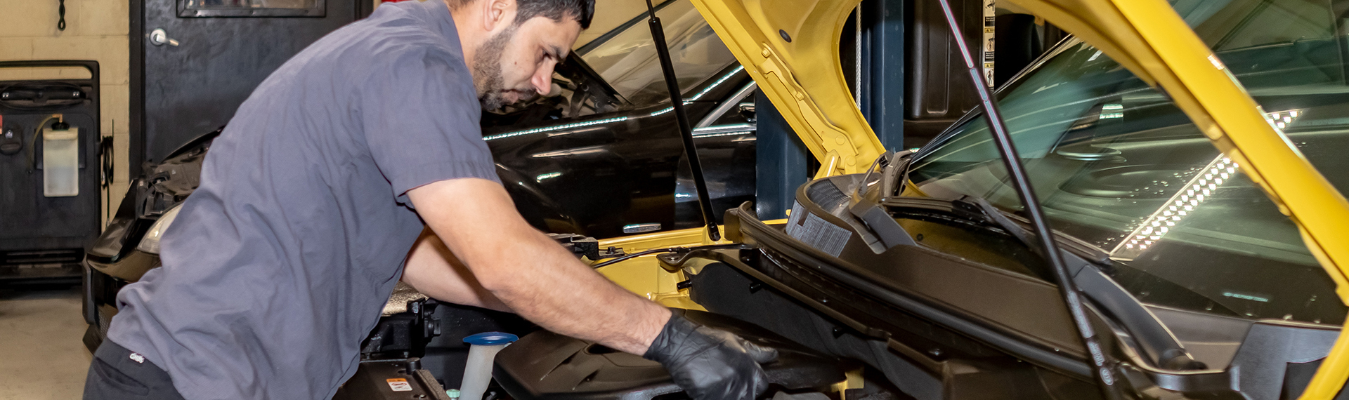 A mechanic works on a vehicle at ATC Auto Center in Augusta, GA