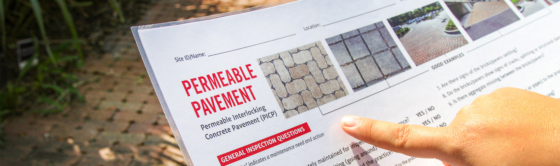 A hand points at a laminated sheet with permeable pavement options