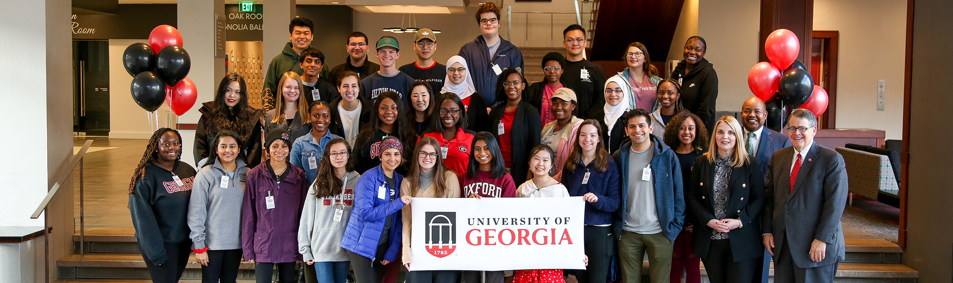 Students and UGA faculty pose for a picture in the Georgia Center to kick off the 2020 Student Tour of Georgia.