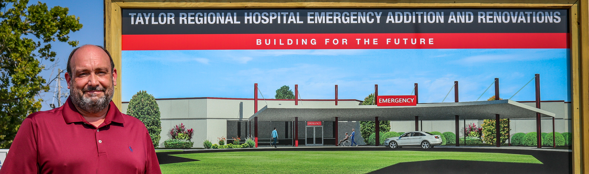 Man stands in front of mock emergency room photo
