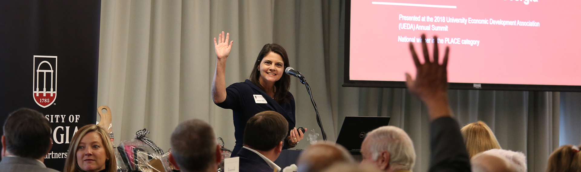 Archway Partnership's Michelle Elliot gives a presentation in front of a crowd in a photo from 2018.