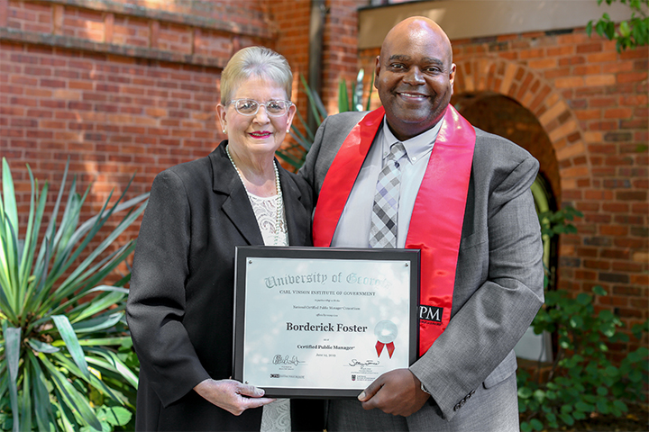 "Hancock County Commission Chair Helen G. ""Sistie"" Hudson with County Clerk Borderick Foster"