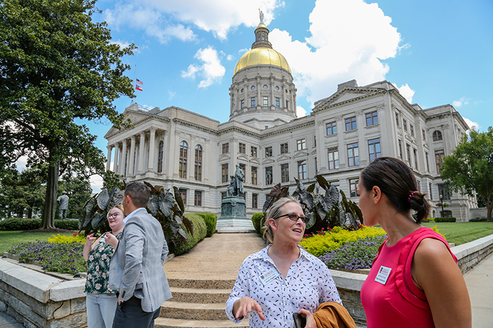 New Faculty Tour members Katie Higgins (L) and Megan Wongkamalasai in front of the Georgia State Capitol in Atlanta (Photo: Shannah Montgomery/PSO)