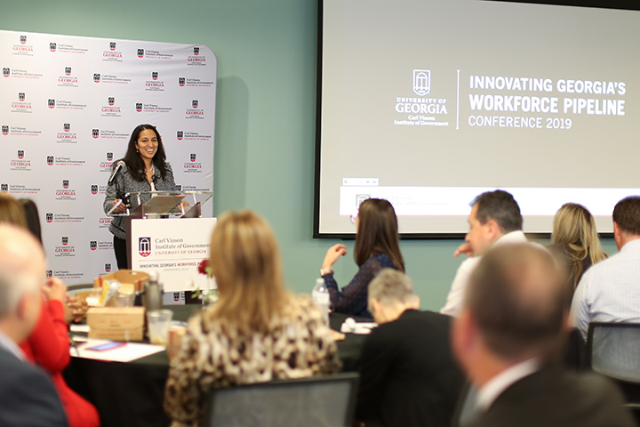 A speaker stands at the podium during the Innovating Georgia's Workforce Pipeline Conference