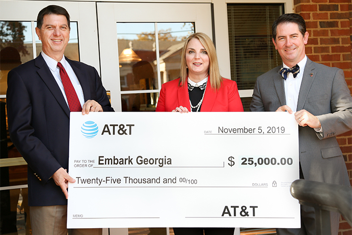 AT&T Northeast Georgia Regional Director External Affairs Paul Chambers, UGA Vice President for Public Service and Outreach Jennifer Frum, J.W. Fanning Institute for Leadership Development Director Matt Bishop pose with Embark Georgia donation check
