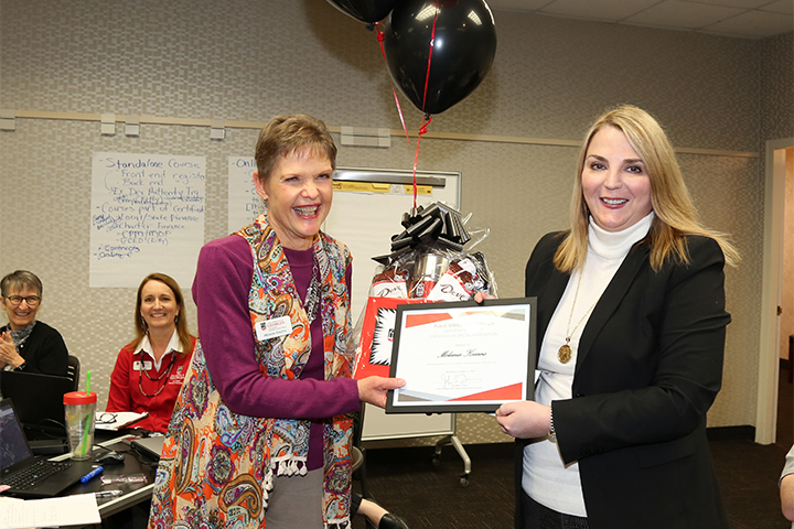 Employee Spotlight winner Melanie Kearns accept her award from Vice President Jennifer Frum.