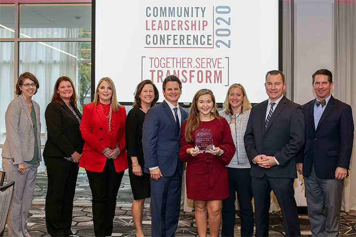 Walnut Grove High School poses with Public Service and Outreach Vice President Jennifer Frum and Fanning Institute Director Matt Bishop after winning the 2020 Innovations in Community Leadership Award.