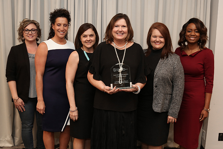 Representatives from the Lynda B Williams Foundation with the Fanning Institute's Innovations in Community Leadership Award in 2019.