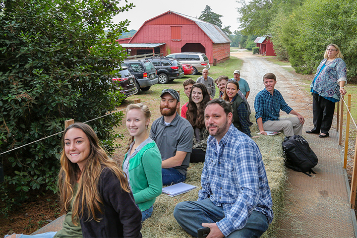UGA students ride on a wagon while touring a farm in Hart County.