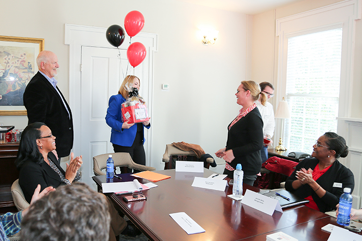 Sara Karlsson is surprised with the PSO Employee Spotlight Award by VP Jennifer Frum.