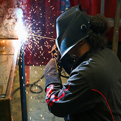 A Thomson High School student practices welding in the school's new training program.