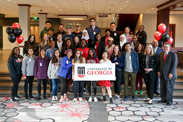 The 34 students of the 2020 Student Tour of Georgia pose with UGA President Jere Morehead, PSO Vice President Jennifer Frum, and Vice President of Student Affairs Victor Wilson.