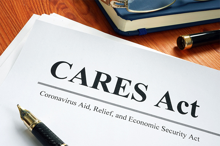 A copy of the CARES Act lying on a desk.