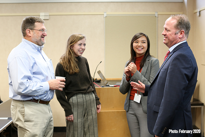 Walt McBride and Stephan Durham talk with grad students Caroline Dickey and Angela Nguyen