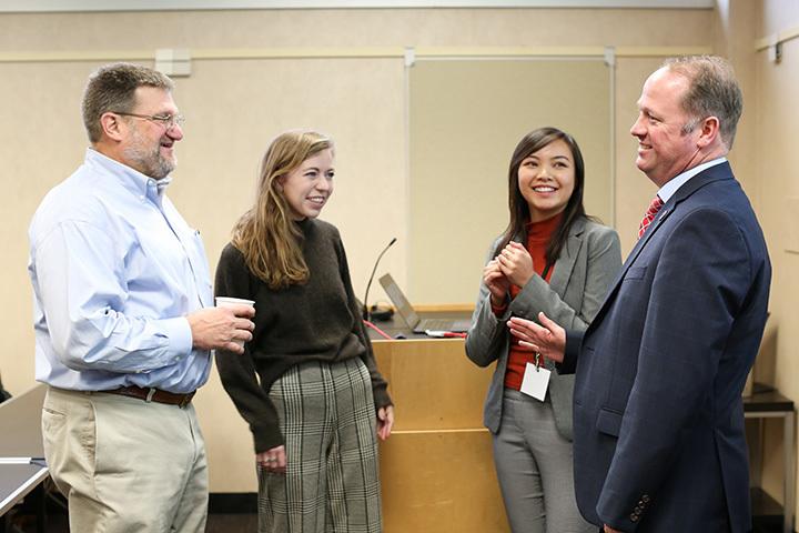 Walt McBride and Stephan Durham talk with grad students Caroline Dickey and Angela Nguyen