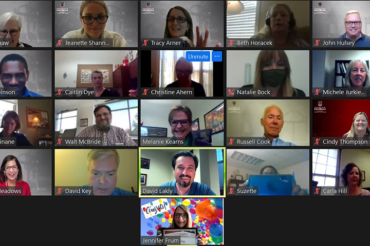 A screenshot of a Zoom meeting surprising Dave Lakly with the Employee Spotlight Award.