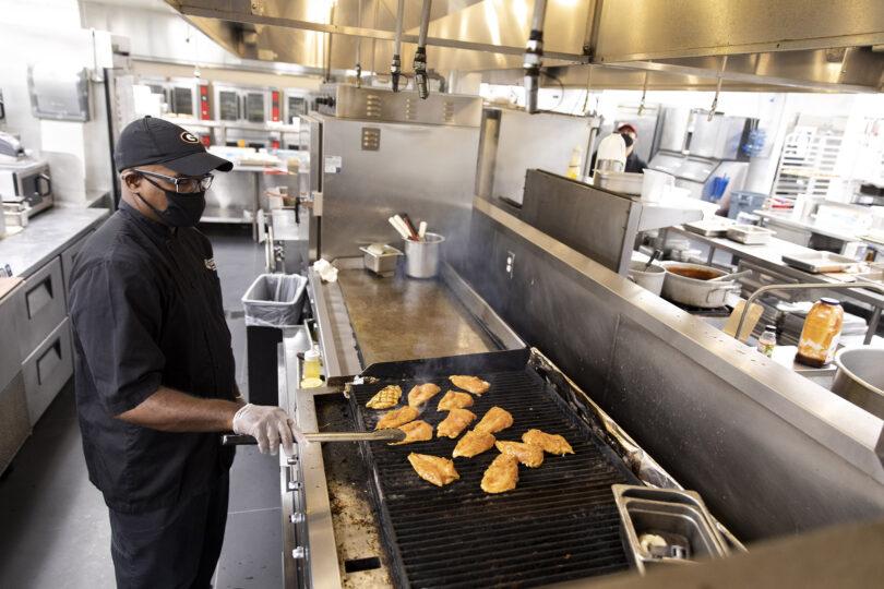 Ronald Bernard cooking chicken on a grill