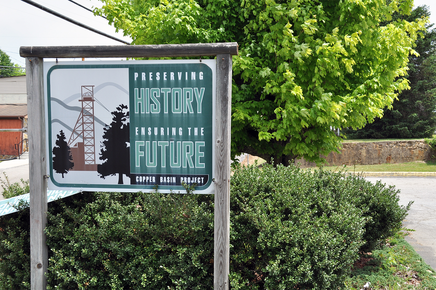 """A sign for the Copper Basin Project saying """"Preserving History, Ensuring the Future."""""""