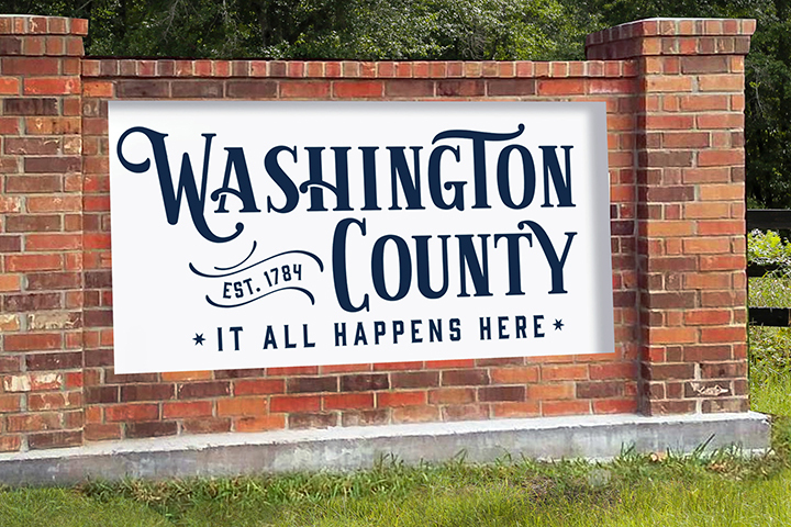 A road sign with the new branding for Washington County