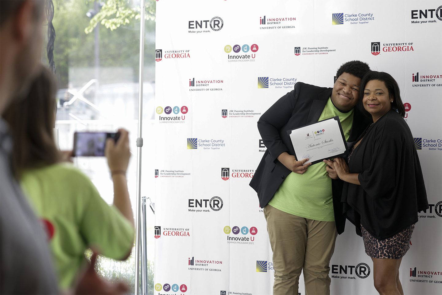 InnovateU participant Antonio Starks poses for a photo with his mother, Ty Starks.