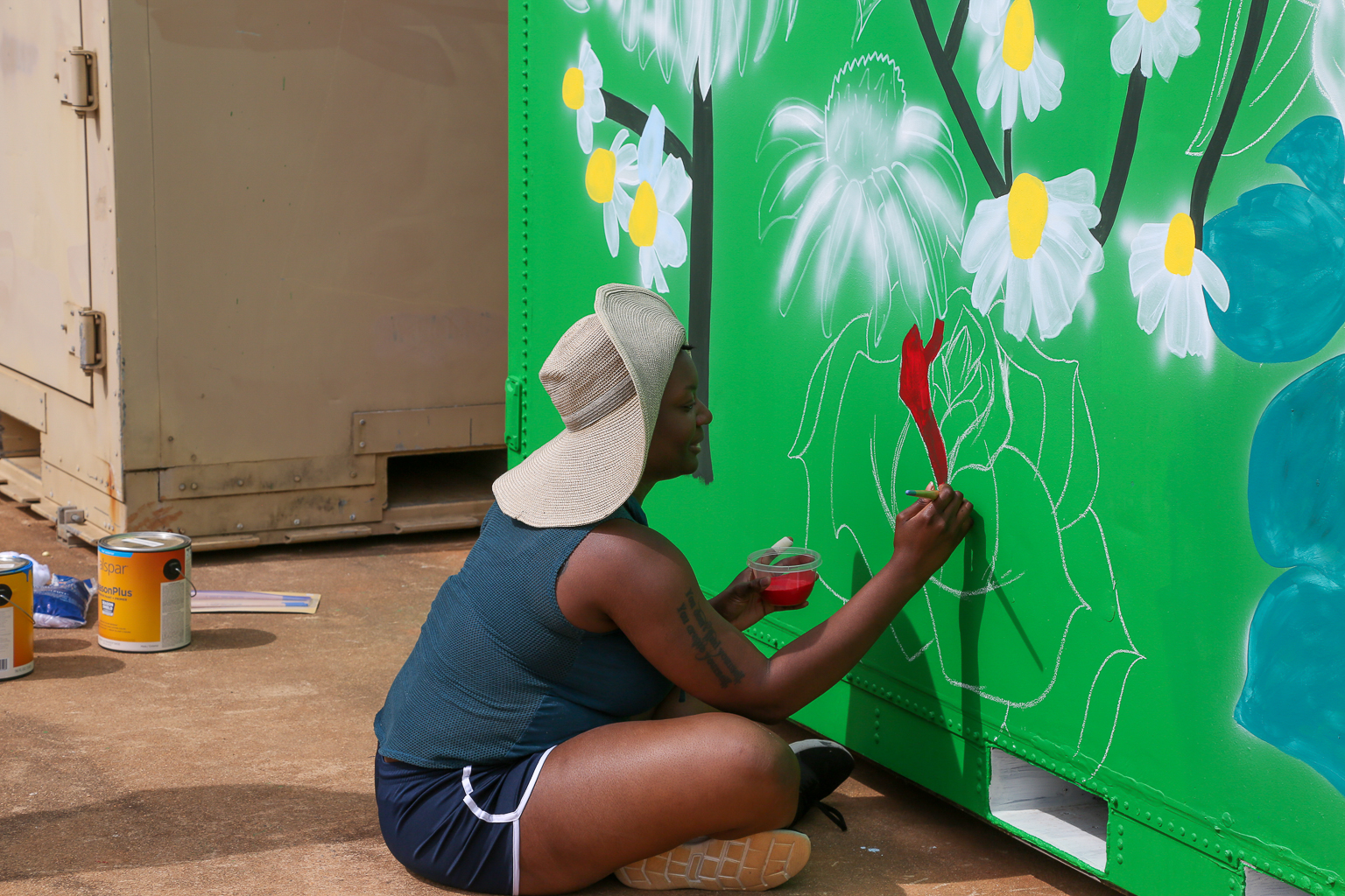 students paint containers