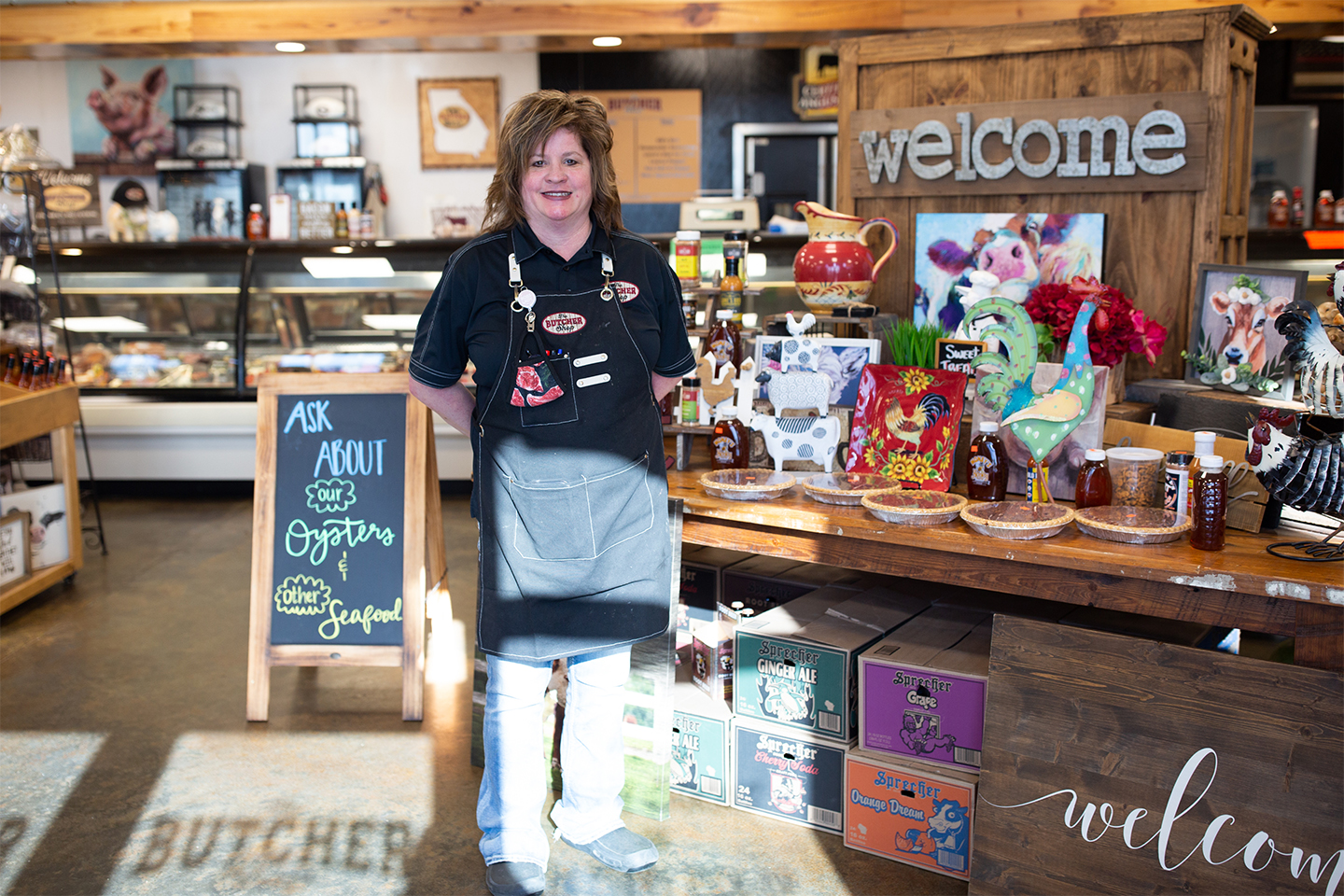 The Butcher Shop owner Amy Dean stands in her store