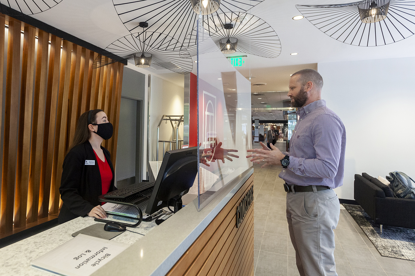 Taylor Grace Hunt helps a guest at the concierge desk of the Georgia Center.